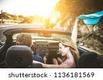 couple of lovers driving on a... | Shutterstock . vector #1136181569