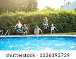children in outside swimming... | Shutterstock . vector #1136192729
