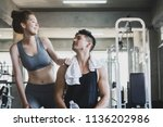 fitness man and asian woman... | Shutterstock . vector #1136202986