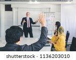 business man hand up for asking ... | Shutterstock . vector #1136203010
