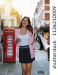 attractive city woman with bags ... | Shutterstock . vector #1136210009