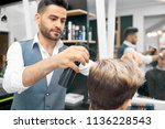 doing new hairstyle for male... | Shutterstock . vector #1136228543