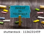 text sign showing invest in... | Shutterstock . vector #1136231459
