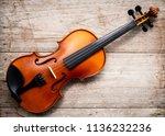 brown violin on wooden... | Shutterstock . vector #1136232236