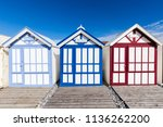 Small photo of Cayeux, France, Baie de Somme, 06-23-2018 : More than 400 cabins remarkably aligned with the sea. Shelters of a day or a season, one can picnic there, settle down to read or watch the children play