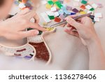 hands of master working on new... | Shutterstock . vector #1136278406