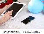 hand hold tablet and touching...   Shutterstock . vector #1136288069