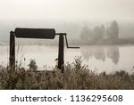 old well and foggy lake   Shutterstock . vector #1136295608