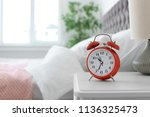 Analog Alarm Clock On Table In...