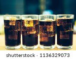 background of cola with ice and ... | Shutterstock . vector #1136329073