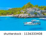 cala macarelleta beach  ove... | Shutterstock . vector #1136333408