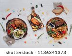 hot dishes. delicious baked... | Shutterstock . vector #1136341373
