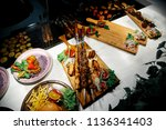 fried pork meat on skewers | Shutterstock . vector #1136341403