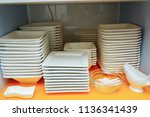 white plates on a shelf in a... | Shutterstock . vector #1136341439
