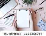 home office desk with laptop ... | Shutterstock . vector #1136366069