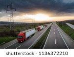 caravan or convoy of red trucks ... | Shutterstock . vector #1136372210