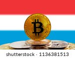 bitcoin btc on stack of... | Shutterstock . vector #1136381513