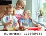 happy grandmother with her... | Shutterstock . vector #1136409866