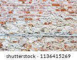 the wall made of red bricks and ...   Shutterstock . vector #1136415269