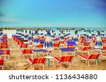 sunshades and deck chairs of... | Shutterstock . vector #1136434880
