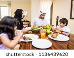 happy arabian family having fun ... | Shutterstock . vector #1136439620
