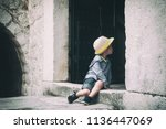 little boy in a straw hat... | Shutterstock . vector #1136447069