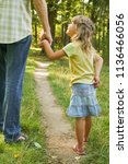 the parent holding the child's... | Shutterstock . vector #1136466056