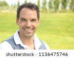 happy man outside | Shutterstock . vector #1136475746