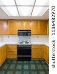 old condo kitchen vertical view ... | Shutterstock . vector #1136482970