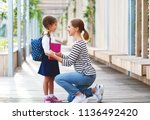 first day at school. mother... | Shutterstock . vector #1136492420
