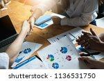 business partnership meeting... | Shutterstock . vector #1136531750