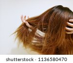 young woman holding long...   Shutterstock . vector #1136580470