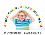 happy preschool child learning... | Shutterstock . vector #1136585756