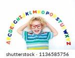 happy preschool child learning... | Shutterstock . vector #1136585756
