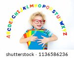 happy preschool child learning... | Shutterstock . vector #1136586236