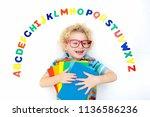 happy preschool child learning... | Shutterstock . vector #1136586236