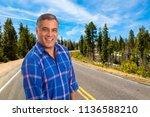 handsome middle age hispanic... | Shutterstock . vector #1136588210
