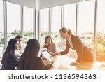 businesswoman team are talking... | Shutterstock . vector #1136594363