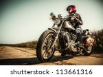 biker girl sits on a motorcycle | Shutterstock . vector #113661316