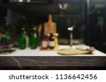 empty black stone table top and ... | Shutterstock . vector #1136642456