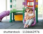 happy young mother and her cute ... | Shutterstock . vector #1136662976