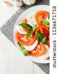 close up photo of caprese salad ... | Shutterstock . vector #1136671718