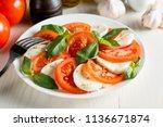 close up photo of caprese salad ... | Shutterstock . vector #1136671874