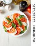 close up photo of caprese salad ... | Shutterstock . vector #1136671880