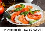 close up photo of caprese salad ... | Shutterstock . vector #1136671904