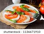 close up photo of caprese salad ... | Shutterstock . vector #1136671910