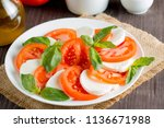 close up photo of caprese salad ... | Shutterstock . vector #1136671988