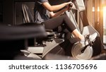 young woman exercise bike... | Shutterstock . vector #1136705696