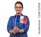 france flag. woman holding... | Shutterstock . vector #1136712926