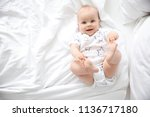cute little baby lying on bed ... | Shutterstock . vector #1136717180